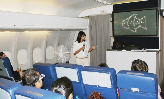 Tania explaining the 'F's and the 'I's of Fittle to ophthalmologists under training on the Orbis plane.